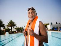 Older adult getting ready to exercise at the swimming pool.