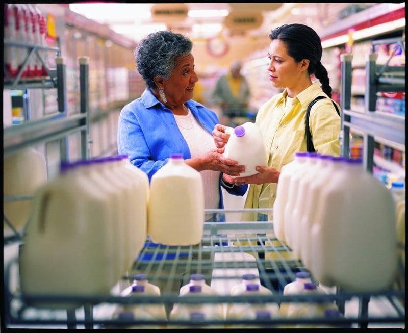 choosing milk grocery store