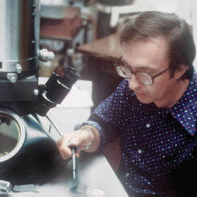 F A Murphy 1976 at electron microscope CDC