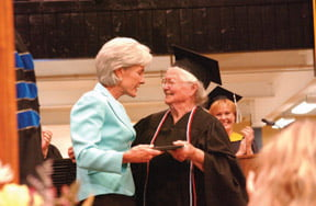 nola ochs receiving diploma
